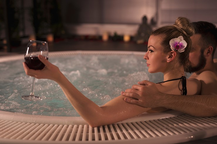 Couple Relaxing in a Jacuzzi | Romantic Spa Break